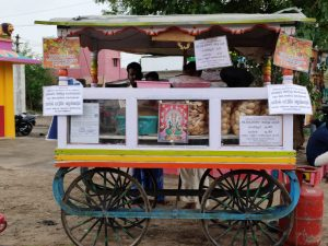Street vendor sells snacks. He received a small grant from AID India to restart his business after lockdown.